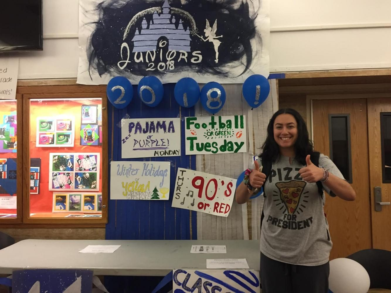 Junior+Lauren+Seltzer+poses+in+front+of+the+junior+table+for+the+first+day+of+Spirit+Week.+On+Monday%2C+students+wore+pajamas+to+school+to+earn+points+for+their+grade.