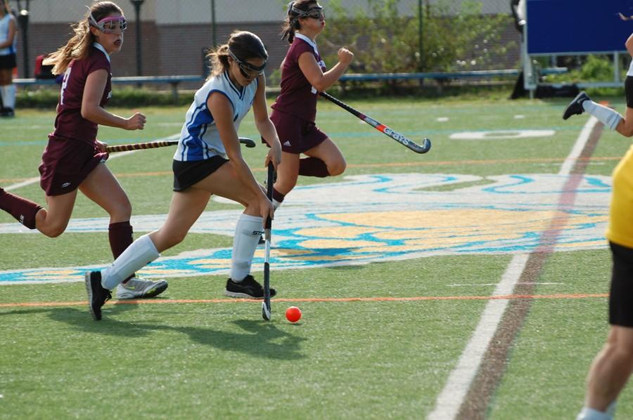Desimone+charges+up+the+field+during+an+overtime+win+against+North+Shore.+She+added+an+assist+as+seniors+Danielle+Rosmarin+and+Olivia+Anderson+scored+for+the+Vikings.+