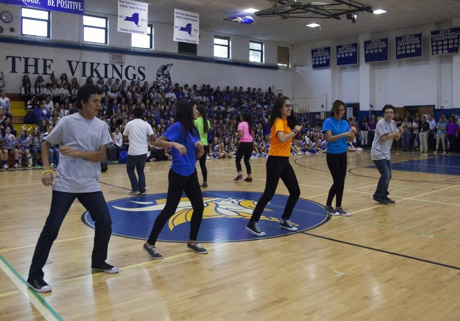 Students+and+staff+move+their+feet+to+the+Latin+beat