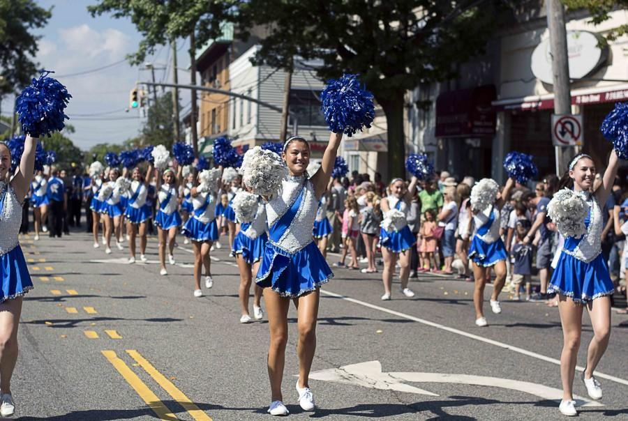 """Seniors Harlee Tung and Aliza Herz lead the Portettes in their routine, which was set to """"Uptown Funk"""" by Bruno Mars. The Portettes marched down Main Street at the start of the parade."""