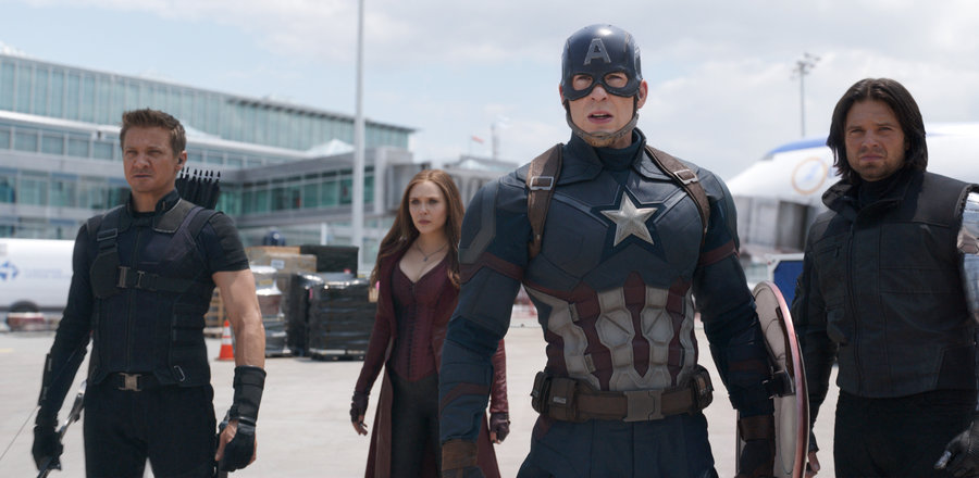 Captain America (Chris Evans) stands among fellow superheroes Hawkeye (Jeremy Renner), Scarlet Witch (Elizabeth Olsen), and Bucky Barnes (Sebastian Stan) before a fight.