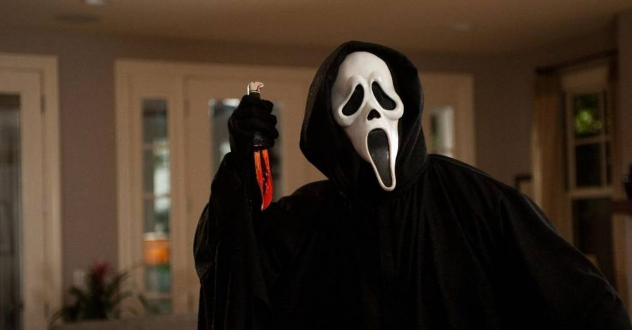 The mysterious villain of Scream wears the iconic ghostface mask, concealing his identity as he faces off with the film's heroine Sidney Prescott, played by Neve Campbell.