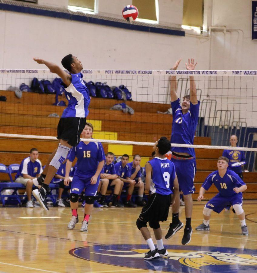 Senior+captain+Connor+MacPhail+jumps+up+to+serve+in+the+Vikings+quarterfinal+match+against+East+Meadow+on+Nov.+5.