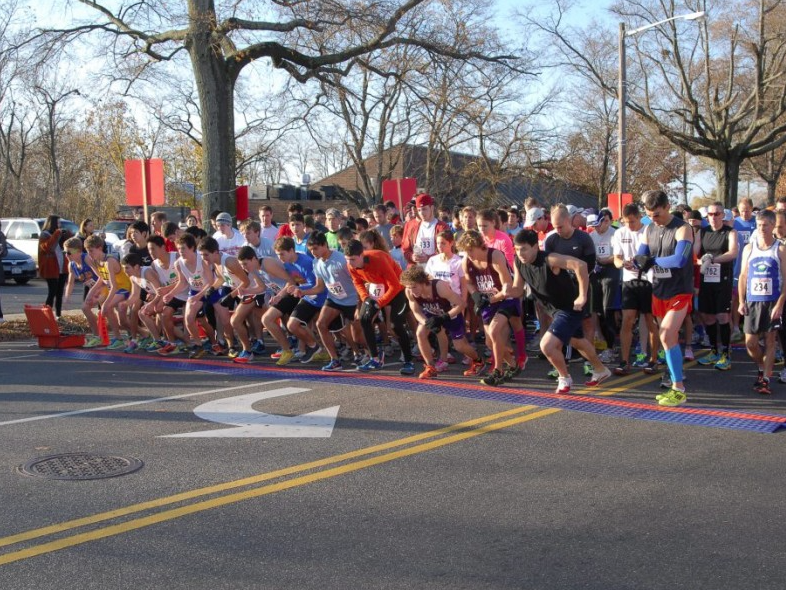 Runners+line+up+along+Manorhaven+Boulevard+on+Thanksgiving+to+begin+running+the+41st+annual+Turkey+Trot.+The+Thanksgiving+day+run+consists+of+five+miles+around+the+four+Port+Washington+villages.