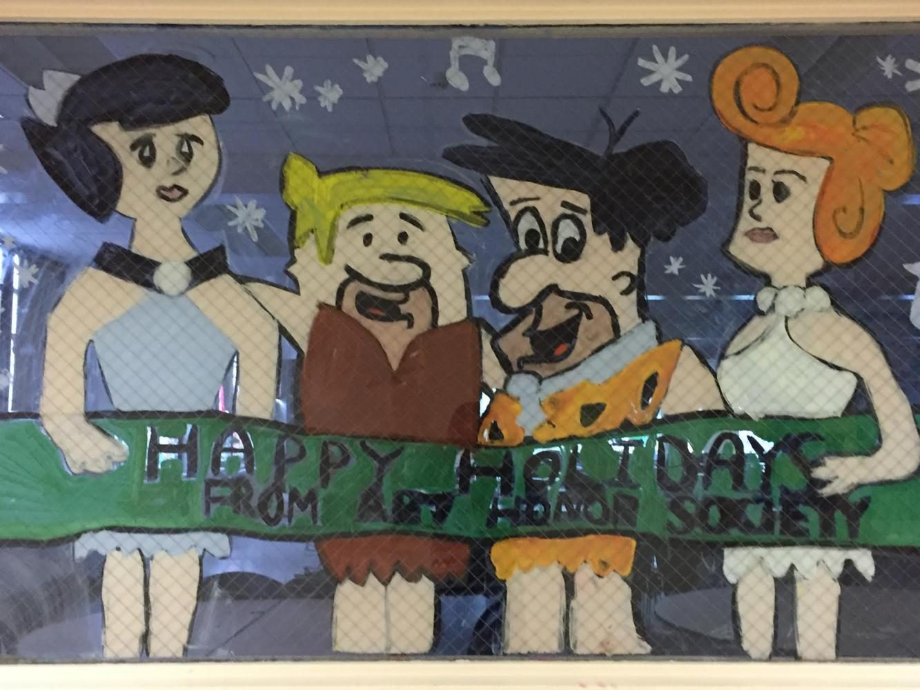 Representatives+from+the+Art+Honors+Society+illustrate+characters+from+The+Flintstones+for+the+holiday+window+painting+event.