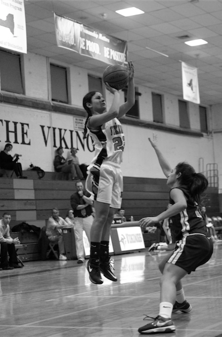 Junior+Emma+Waxman+takes+a+jumpshot+from+long+range+over+a+defender+against+Valley+Stream+Central+on+Jan.+16.+The+Vikings+won+the+game+57-32.