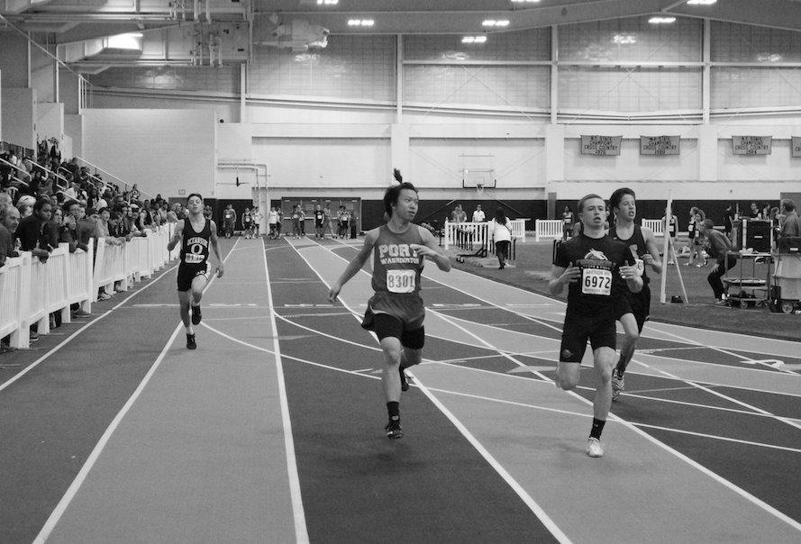 Junior+Kitman+Lam+runs+to+the+finish+line+in+the+300+meter+dash+at+a+track+meet+on+Jan.+4+held+at+St.+Anthony%27s+High+School.