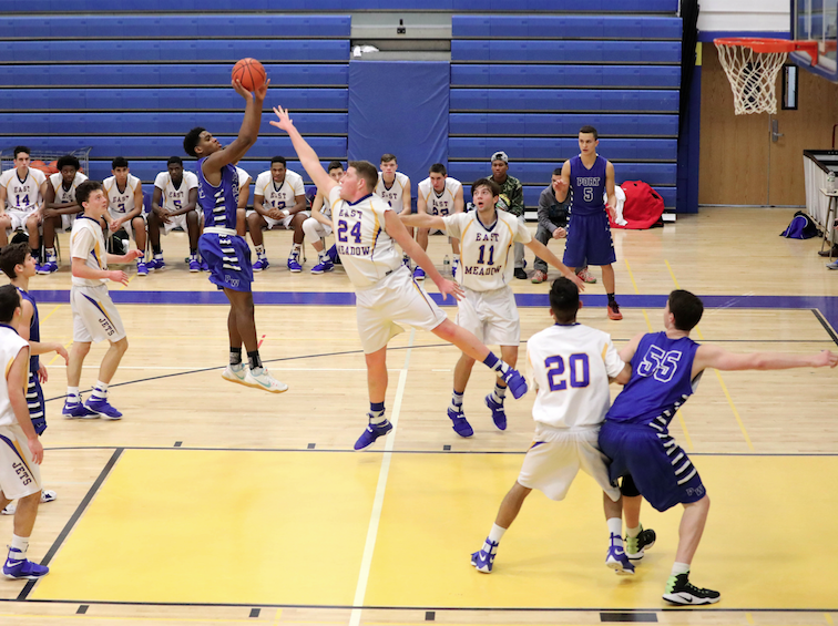 Senior Xavier Merriweather attempts a jump shot in a game against East Meadow on Jan. 10. The Vikings won the game 64-54.