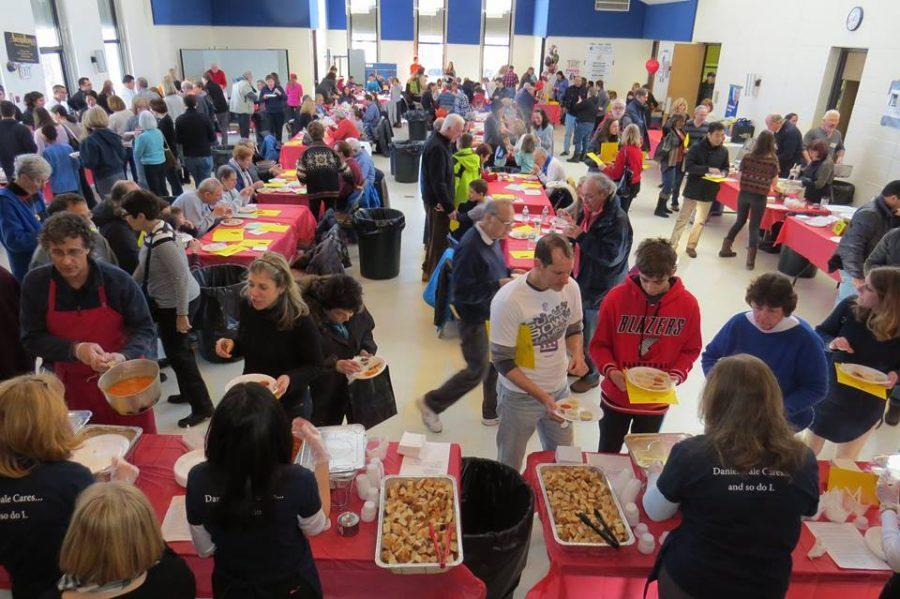 Community+members+gather+to+sample+a+variety+of+soups+from+local+restaurants+at+the+Souper+Bowl+on+Feb.+4.