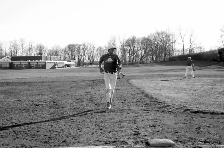 Senior Mitchell Levine heading back to his position during a scrimmage at Guggenheim field. Levine is the Vikings' starting third baseman this season.