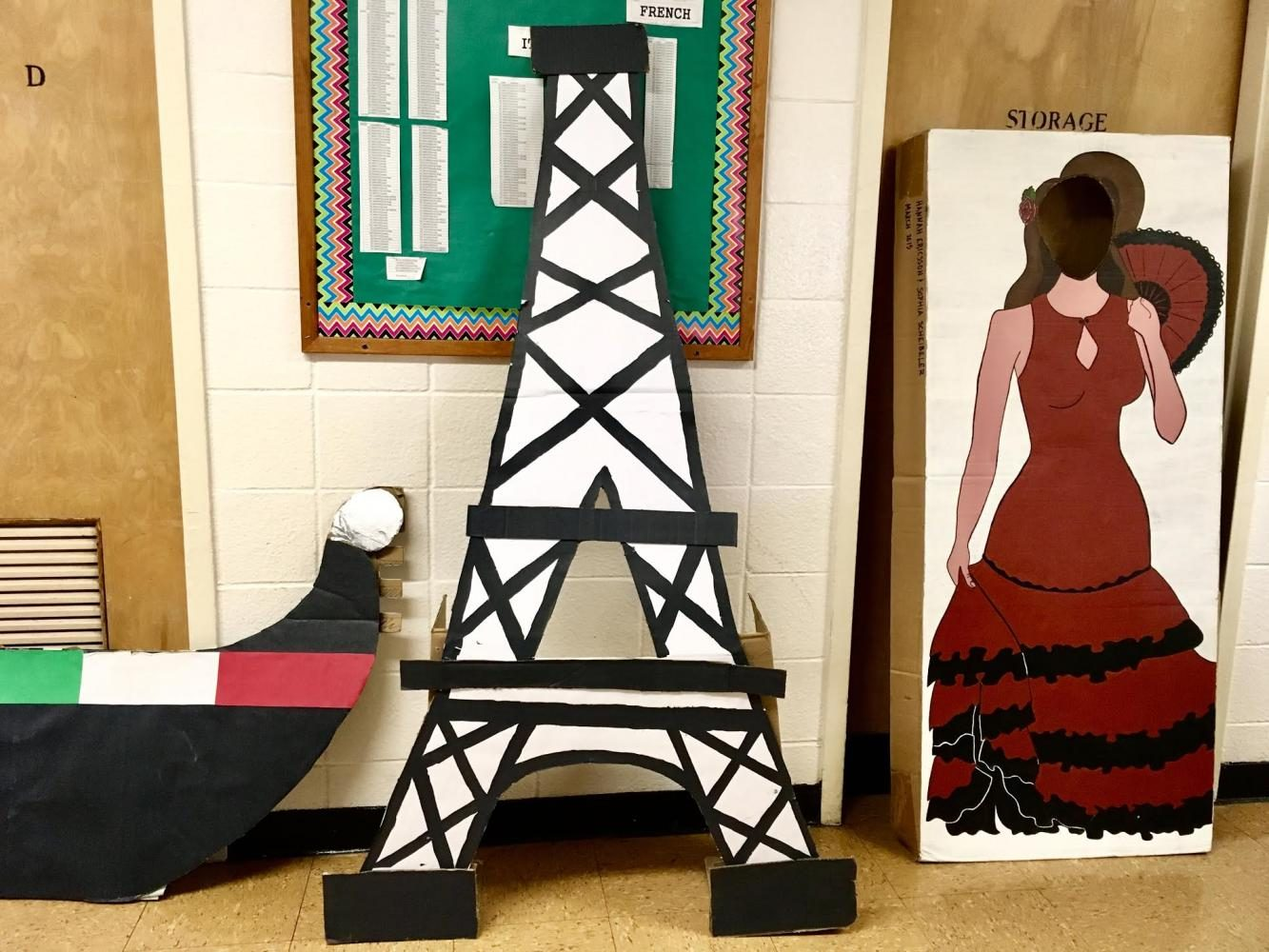 Students+in+the+Foreign+Language+Honor+Society+have+created+cardboard+cutouts+of+the+Eiffel+Tower+and+a+flamenco+dancer+for+French+Day+and+Spanish+Day%2C+respectively.