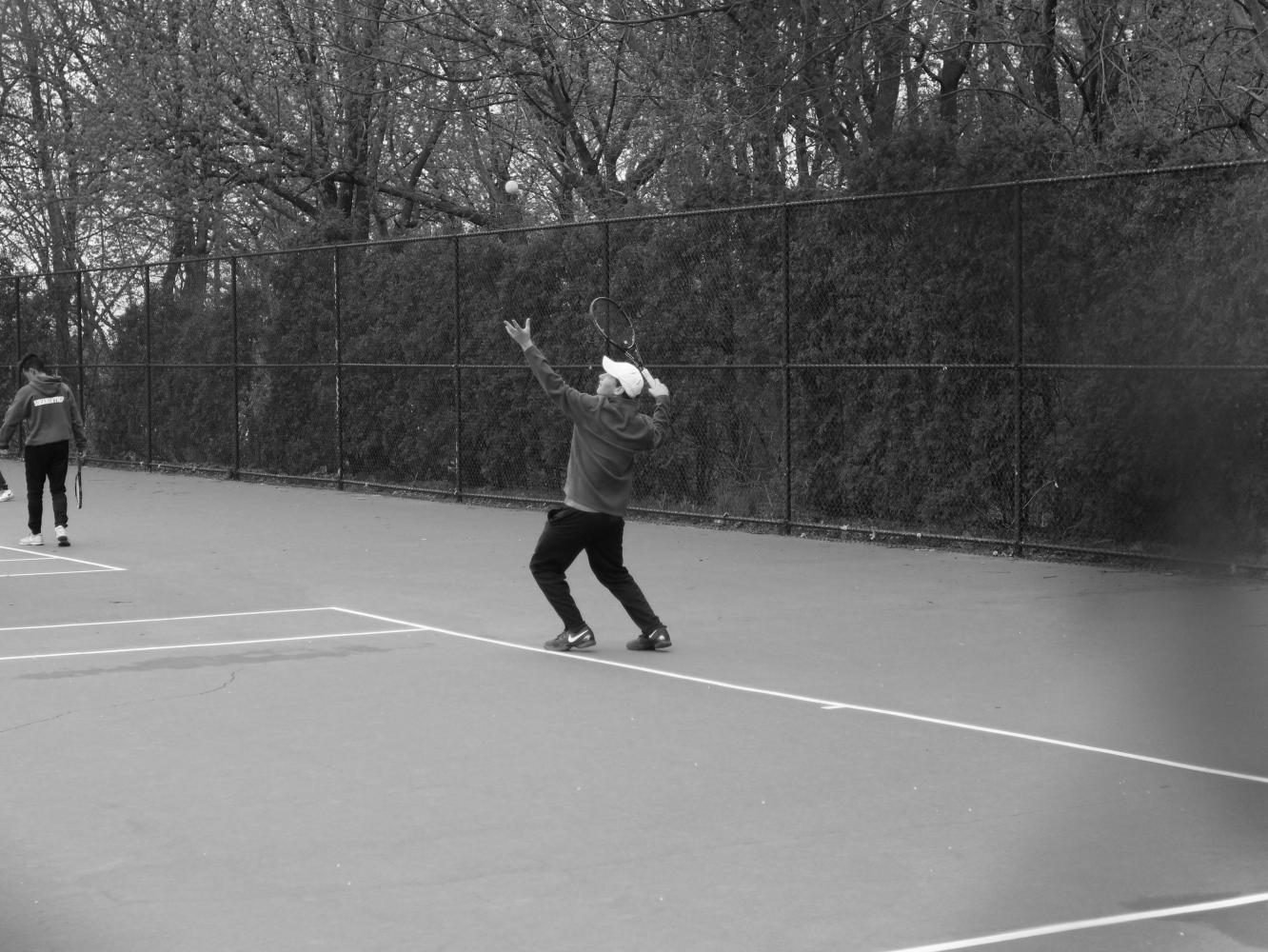 Senior Austin Agna prepares to serve the ball against Cold Spring Harbor at a home match on April 5. The Vikings won the match 6-1.