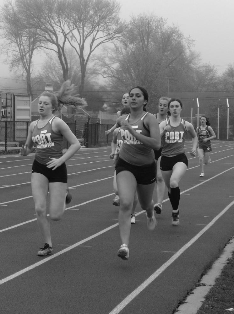 Senior Carly Perlmutter and junior Jenna Rubens run the 800m race at the Port Washington Invitational on April 21.