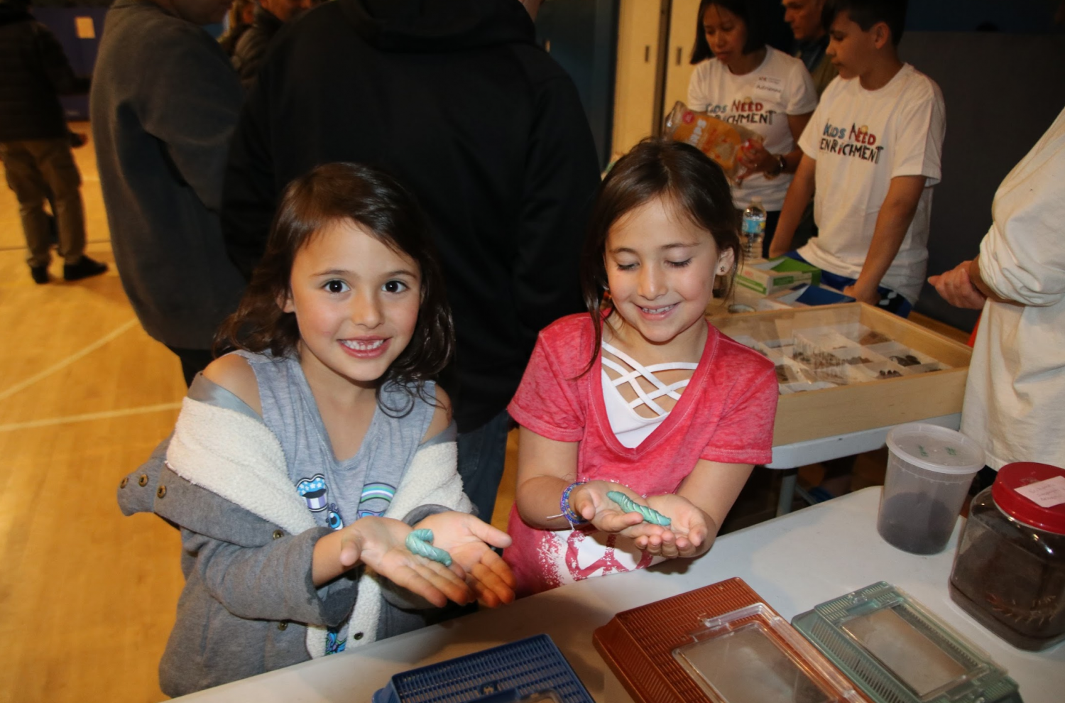 Manorhaven elementary school students learned about different types of insects and hold live caterpillars at the Insects and Arachnids station. Louis Sorkin from the American Museum of Natural History showed children the unique anatomy and adaptations of different species of insects.