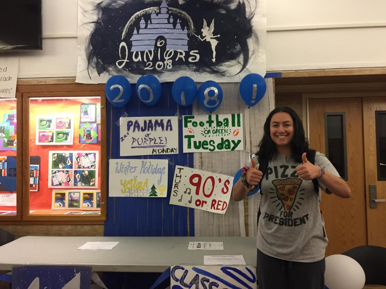 Junior Lauren Seltzer poses in front of the junior table for the first day of Spirit Week. On Monday, students wore pajamas to school to earn points for their grade.