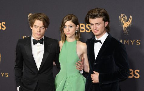 The stars of Stranger Things, Charlie Heaton, Natalia Dyer, and Joe Keery pose for a picture at the Emmys. Fans excitedly await the release of Stranger Things on Netflix on October 27.