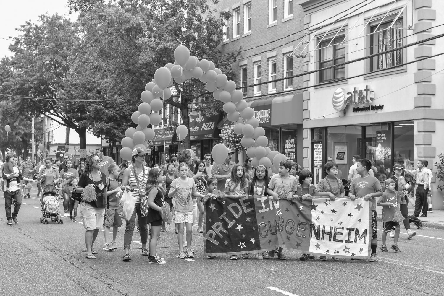 Guggenheim students march in the 29th annual Pride in Port parade, an event that has held a hallmark spot in the town for many years.
