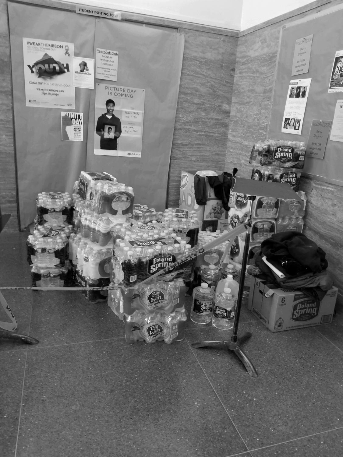 Schreiber collected donations of water bottles from students in the main lobby
