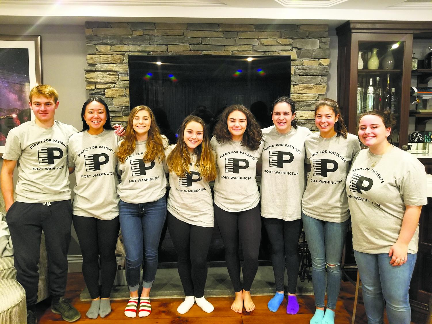 The Port Washington Chapter of Piano for Patients members AJ Siciliano, Sherry Shi, Valentina Scotto, Sarabeth Schiff, Emma Klein, Emma Goldman, Sofia Kuusisto, and Eden Franco. The group performed their instruments once a month for the Sands Point Center for Health and Rehabilitation.