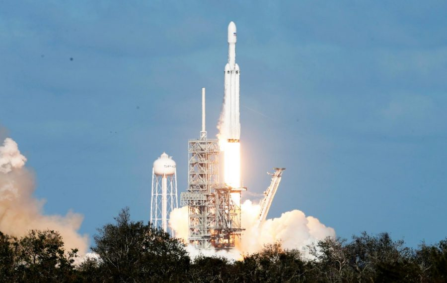 The+Falcon+Heavy+launches+from+Cape+Canaveral%2C+Florida+on+Tuesday%2C+February+6th.+The+rocket+was+carrying+a+Tesla+Roadster+and+was+being+tested+as+the+most+powerful+rocket+in+the+world.