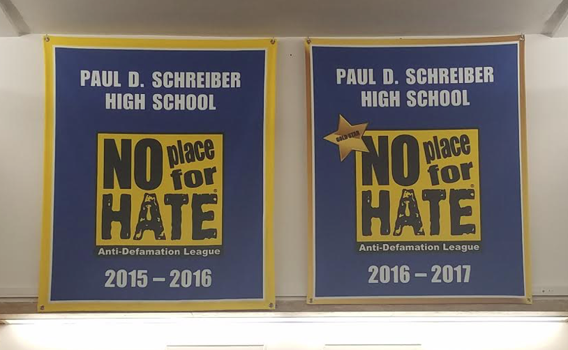 The+No+Place+for+Hate+banners+Schreiber+received+for+the+2015-2016+and+2016-2017+school+years+are+displayed+in+the+main+lobby.
