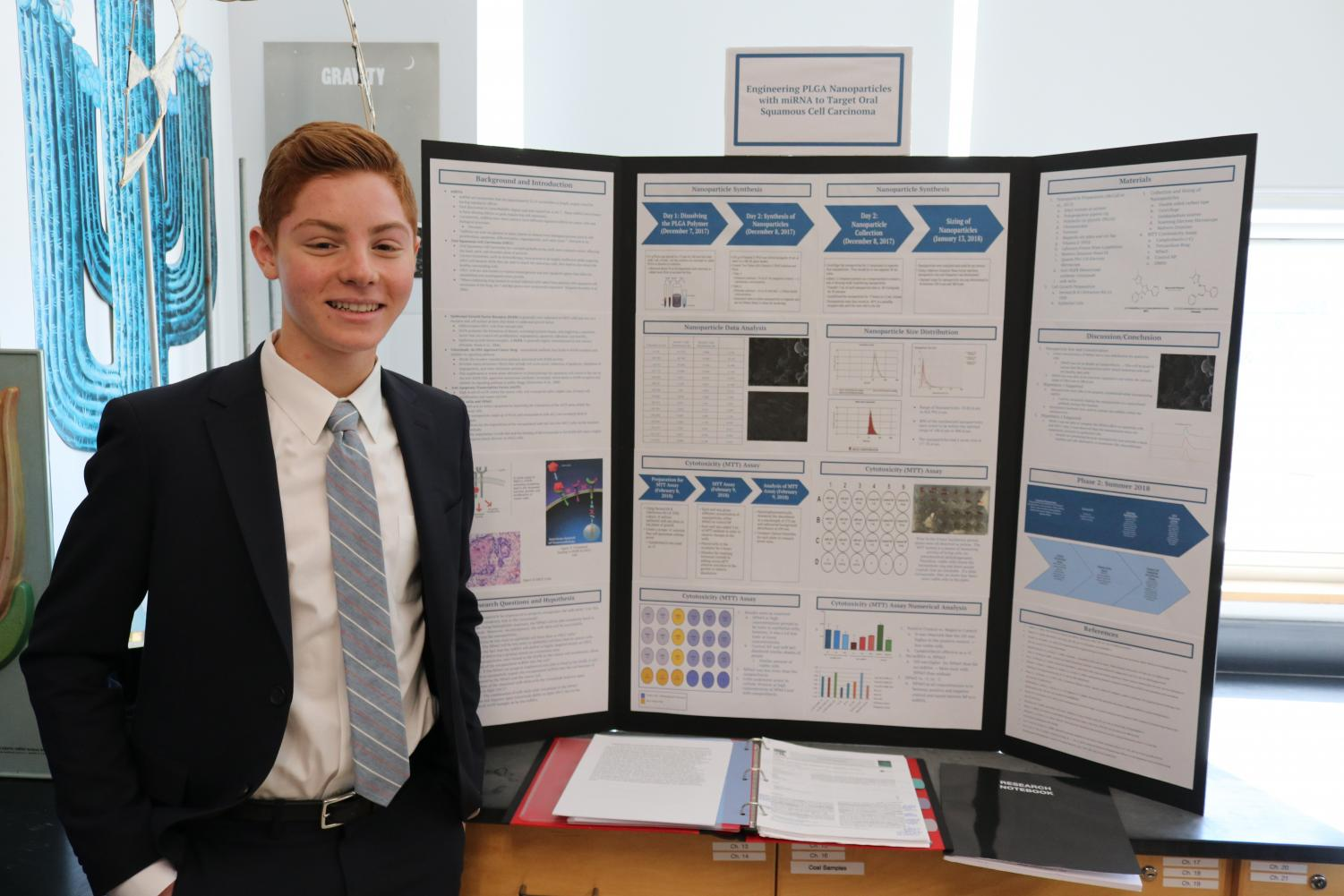 Science research student Ryan Siegel presents his work on engineering cells.