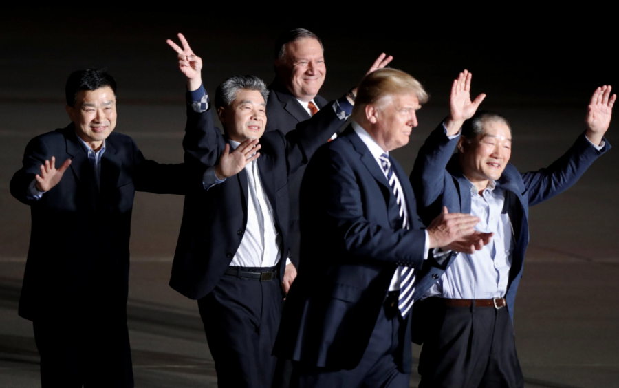 In Washington, D.C. President Donald Trum (front) and Secretary of State Mike Pompeo (rear) welcome home three detainees released from North Korea.