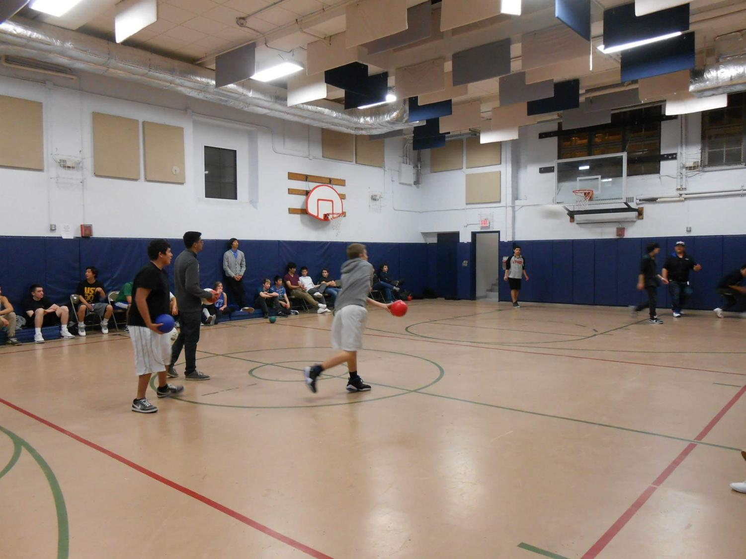 Some members of the PIT Youth Council play an intense game of dodgeball on May 4 in the Landmark building.