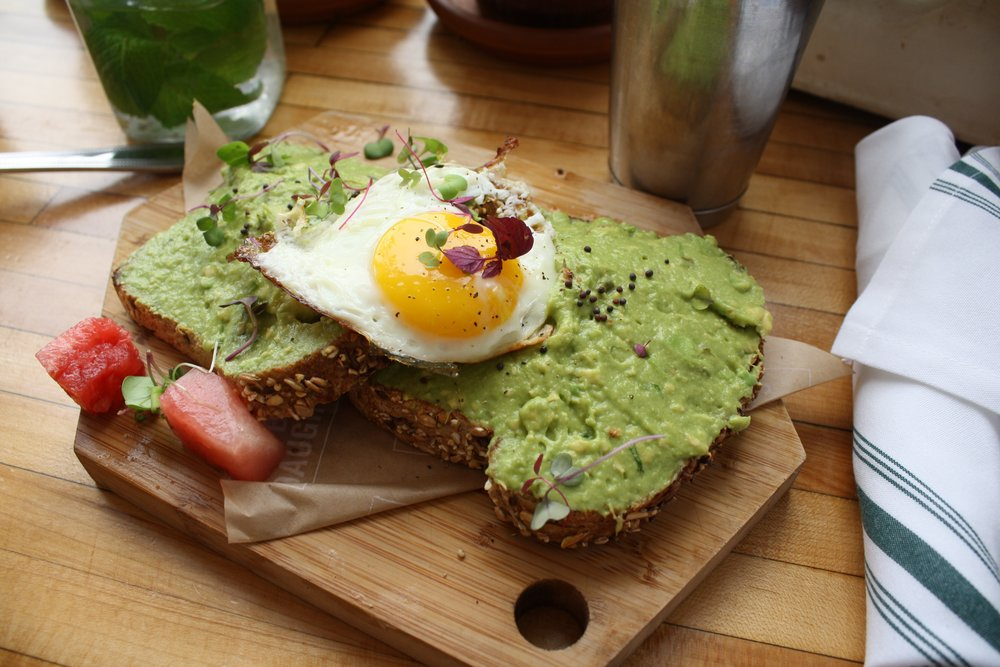 The Butcher's Daughter is the perfect spot for all things avocado toast. Pictured about, this avocado toast is topped with an egg and a special garnish.