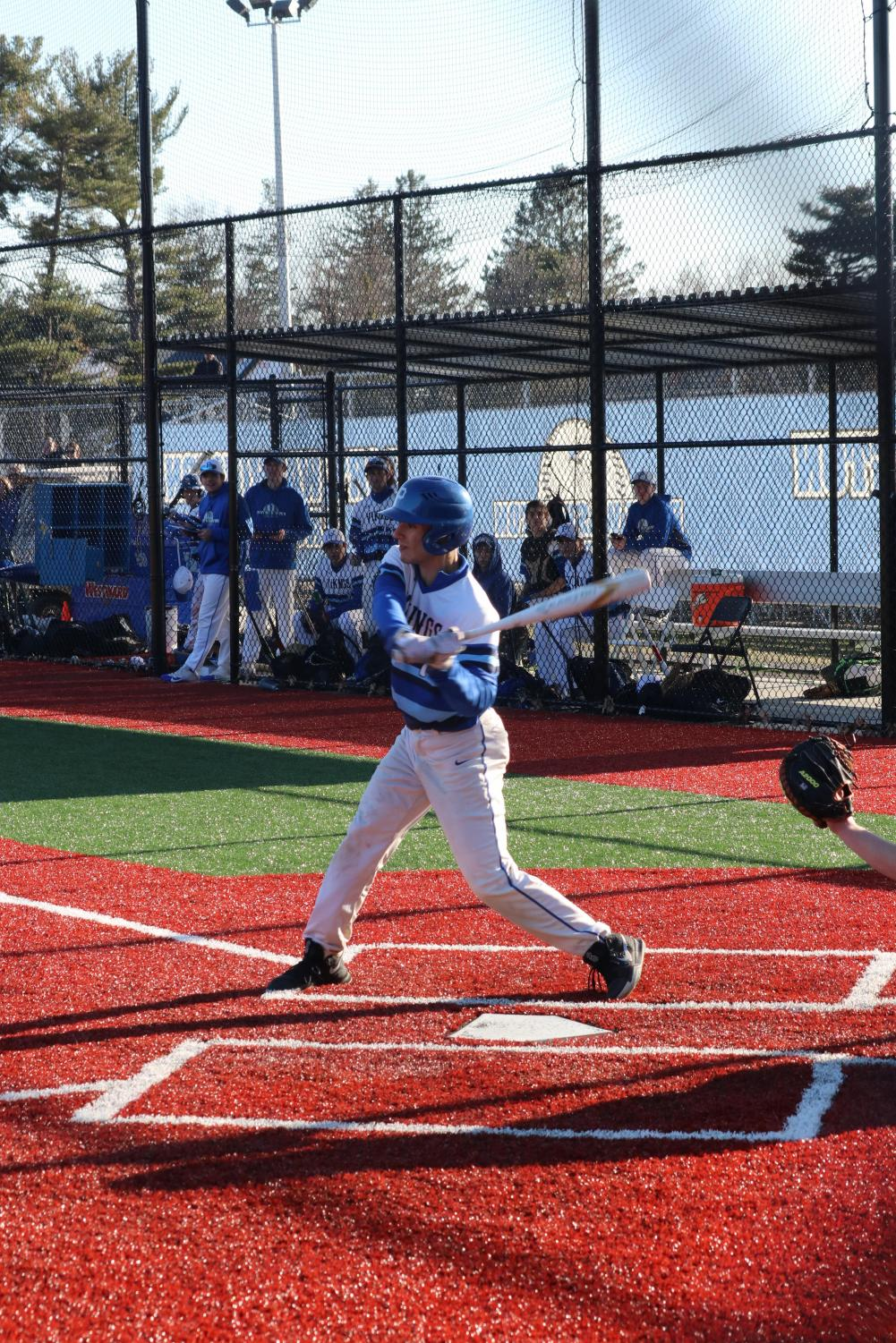Senior Jack Stopler hacks at a pitch during a home game against Hicksville on March 29.  The team went on to win the game 10-5.