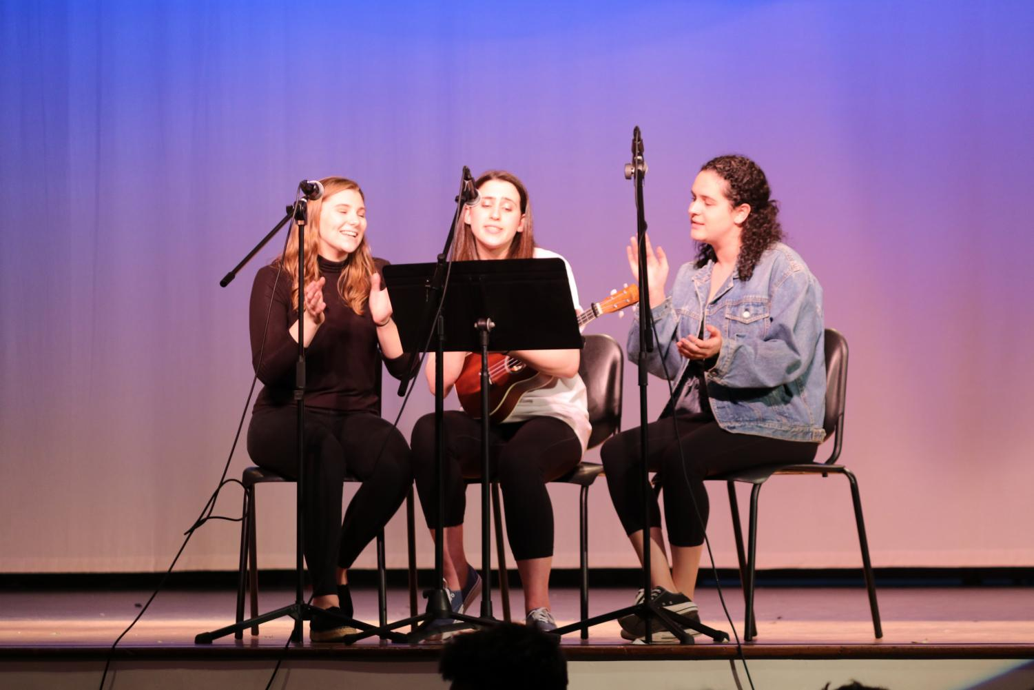 Seniors Valentina Scotto, Julia Gurlitz, and Emma Goldman perform during fifth period. Shakespeare Day was held throughout the school day on April 23, in the auditorium.