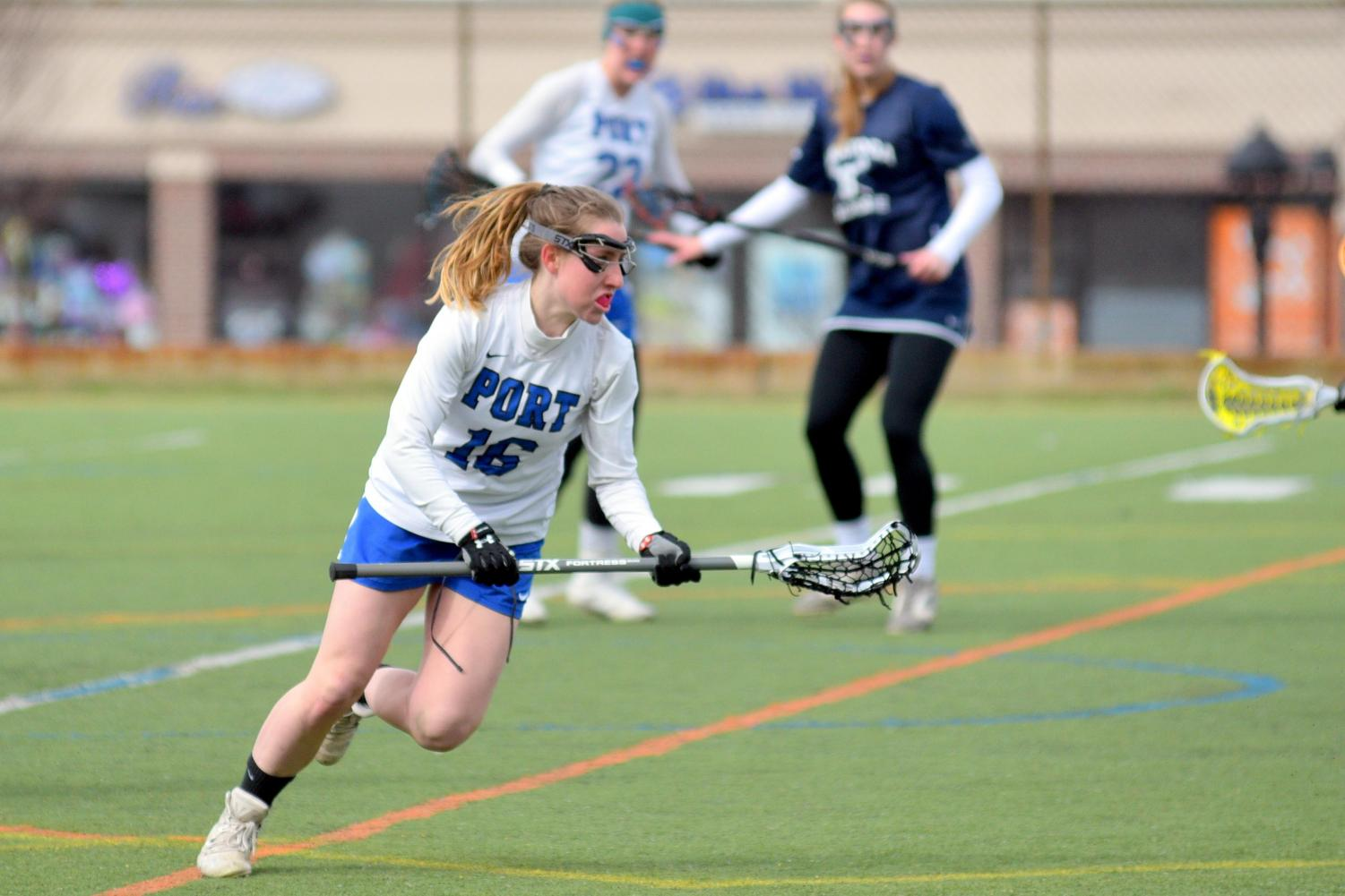 Senior Ali Hoffman looks to advance the ball in a home game against Saratoga Springs on April 7.  The Vikings went on to win the game 12-9.