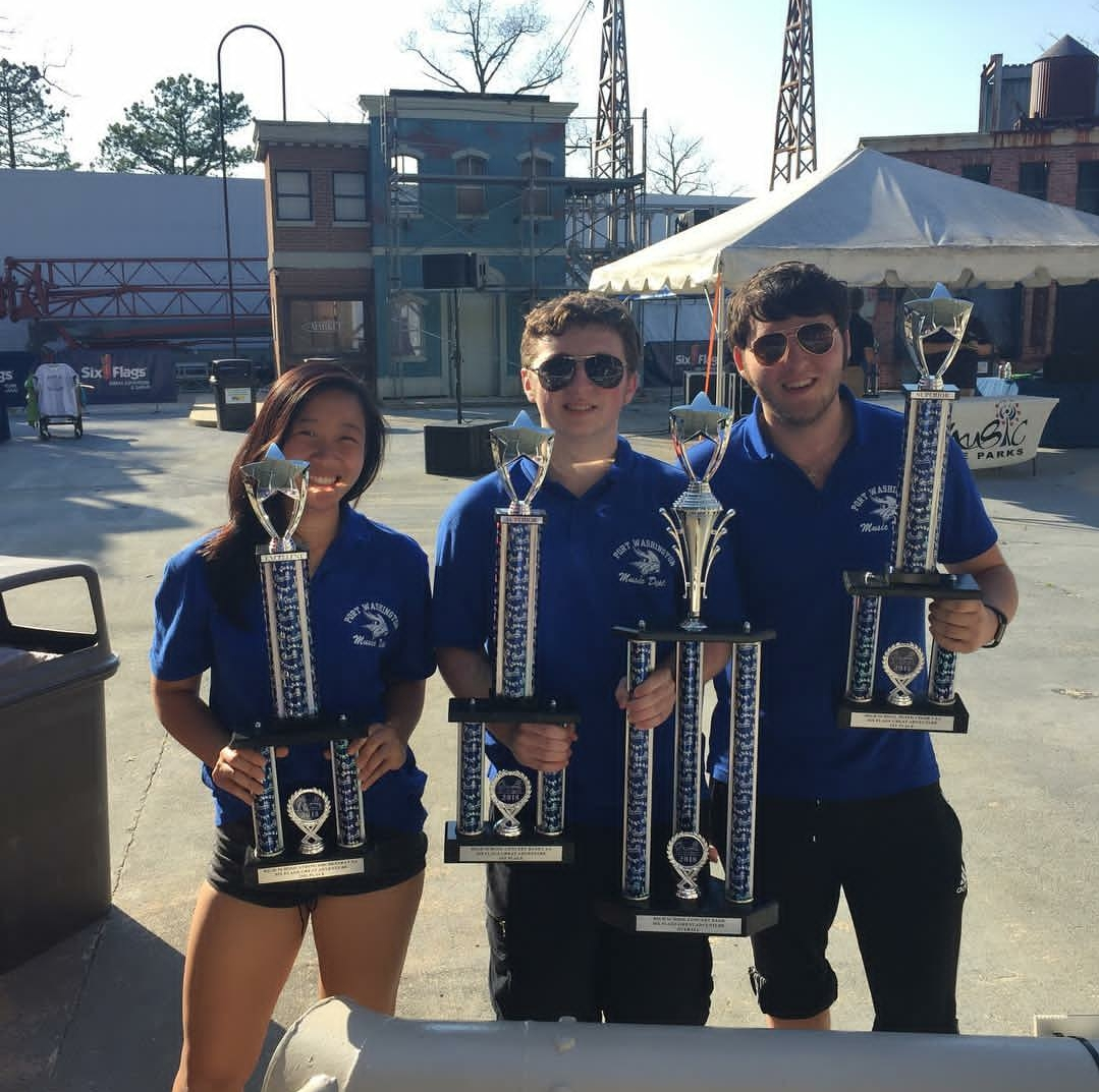 Musicians Meagan Tsou, Jared Wofse and Colin Katz celebrate Schreiber's Victories at the Music in the Park Festival.