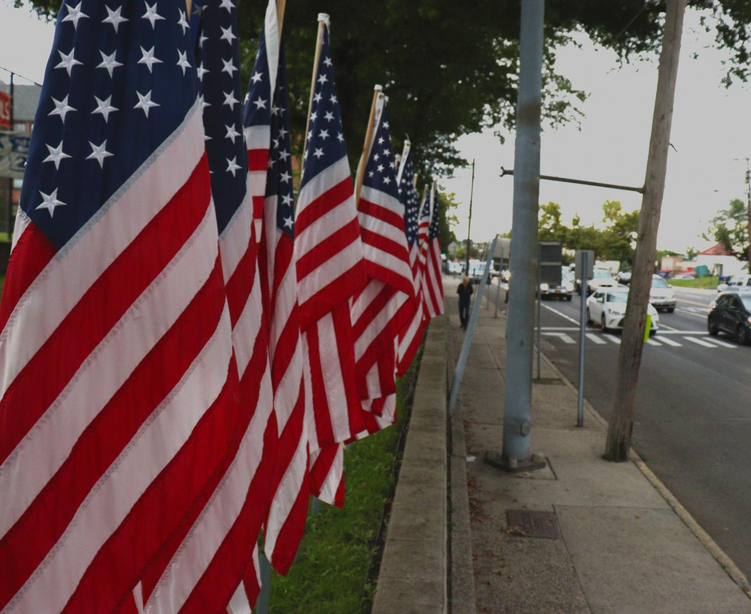 The flags set up by the American Heroes Club are meant to honor those who passed in the tragedy of 9/11, and also represent pride for the United States.