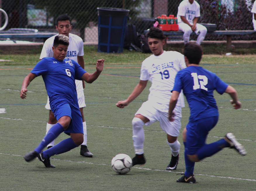 Junior Josh Ramirez takes the ball from a Long Beach athlete on Sept. 20. The Vikings won 6-1.