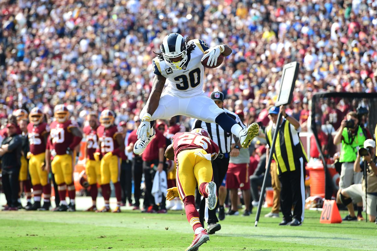 Todd Gurley, a popular first overall pick, hurdles Bashaud Breeland. The Rams lost that game 20-27 to the Redskins.