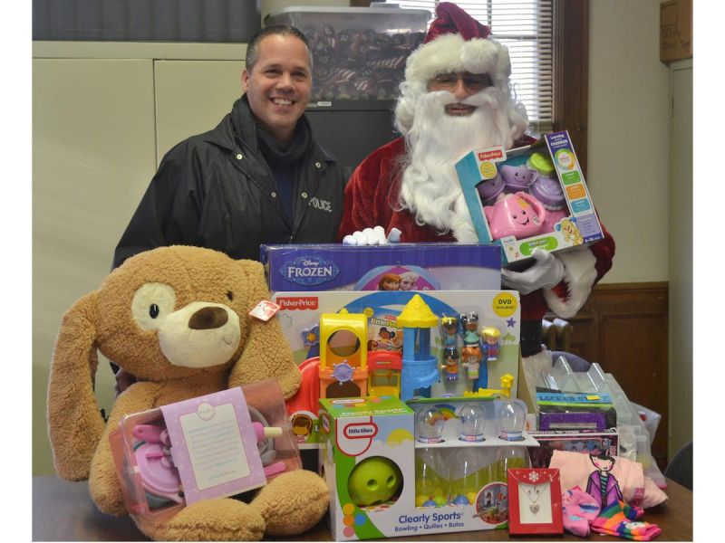 Detective Guzzello helping out Santa at a toy drive in 2016. He frequently makes appearances at local events like the one above.