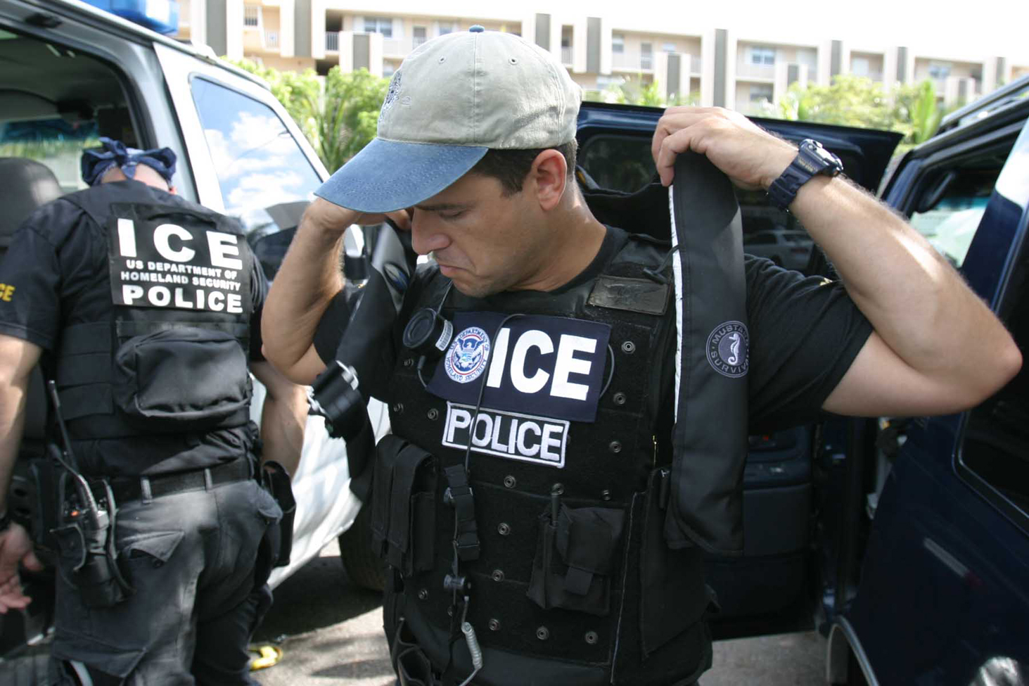 ICE police officers investigate people crossing the border.