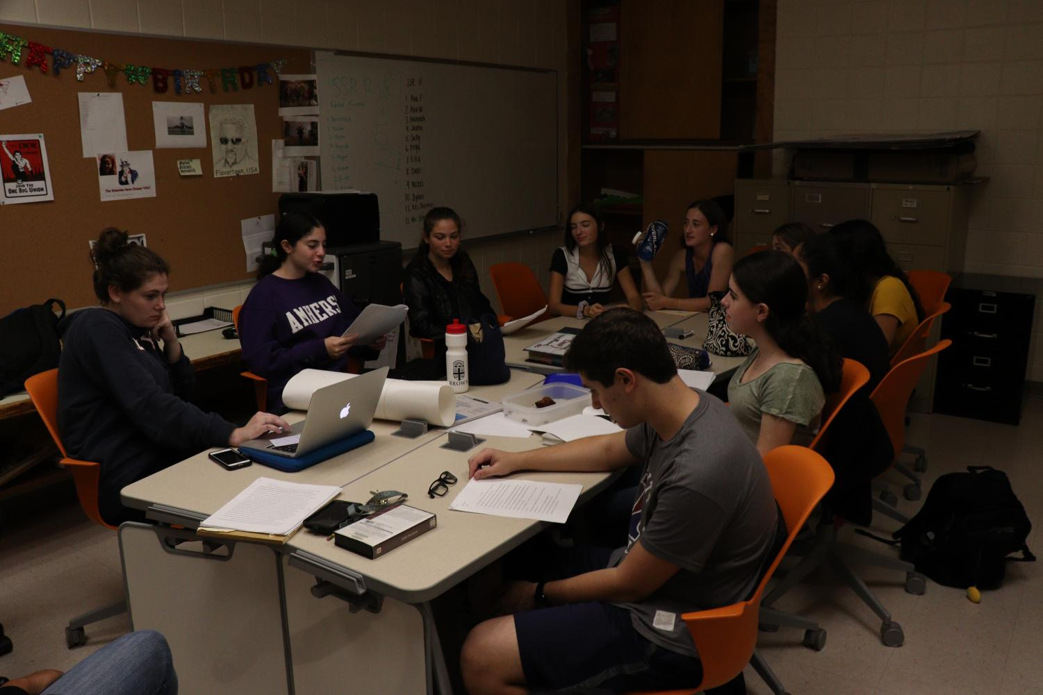 Jaime Levin critiques Ava Fasciano's research paper. The research program facilitates peer editing and collaboration.