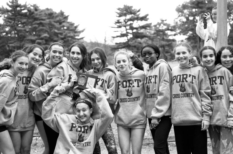 Girls+cross+country+celebrates+after+winning+Conference+Championships+on+Oct.+28.