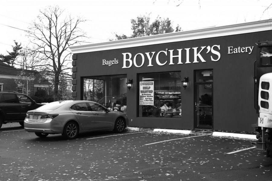 As+Boychik%27s+Eatery+hosts+its+grand+opening%2C+signs+are+placed+in+the+window+as+customers+enjoy+freshly+made+bagels.