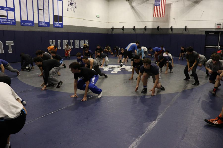 The+varsity+wrestling+team+prepares+for+its+season+during+a+workout+in+the+wrestling+gym.