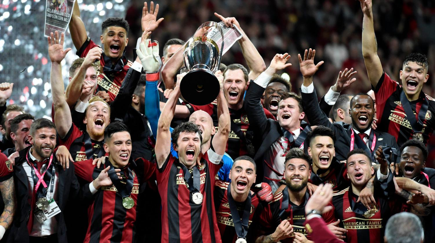 Atlanta United celebrates after defeating the Portland Timbers 2-0, on Dec. 8, to claim the MLS title.