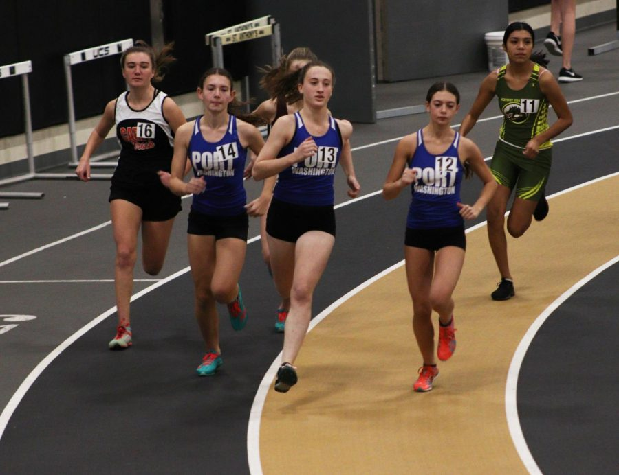 Junior+Sally+Hirshwerk%2C+followed+by+senior+Brittany+Nahas+%28right%29+and+freshman+Emily+Benson-Tyler+%28left%29%2C+race+the+1500M+at+St.+Anthonys%2C+on+Dec.+5.