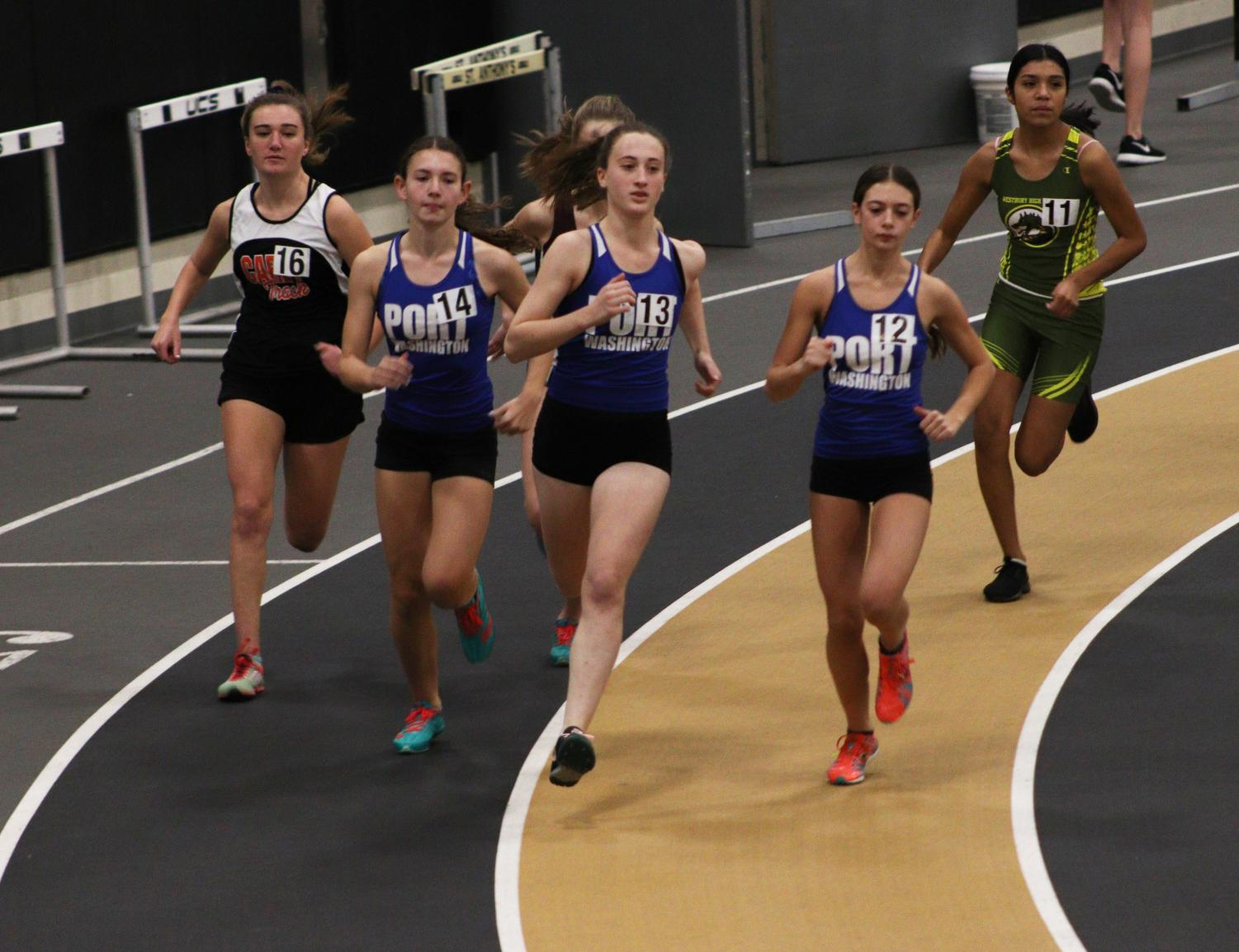 Junior Sally Hirshwerk, followed by senior Brittany Nahas (right) and freshman Emily Benson-Tyler (left), race the 1500M at St. Anthonys, on Dec. 5.