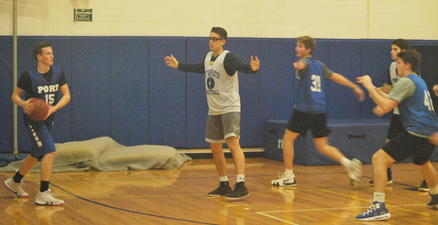 Senior Marc Daly looks to move the ball around junior Matthew Schmitz during a scrimmage on Jan. 10.