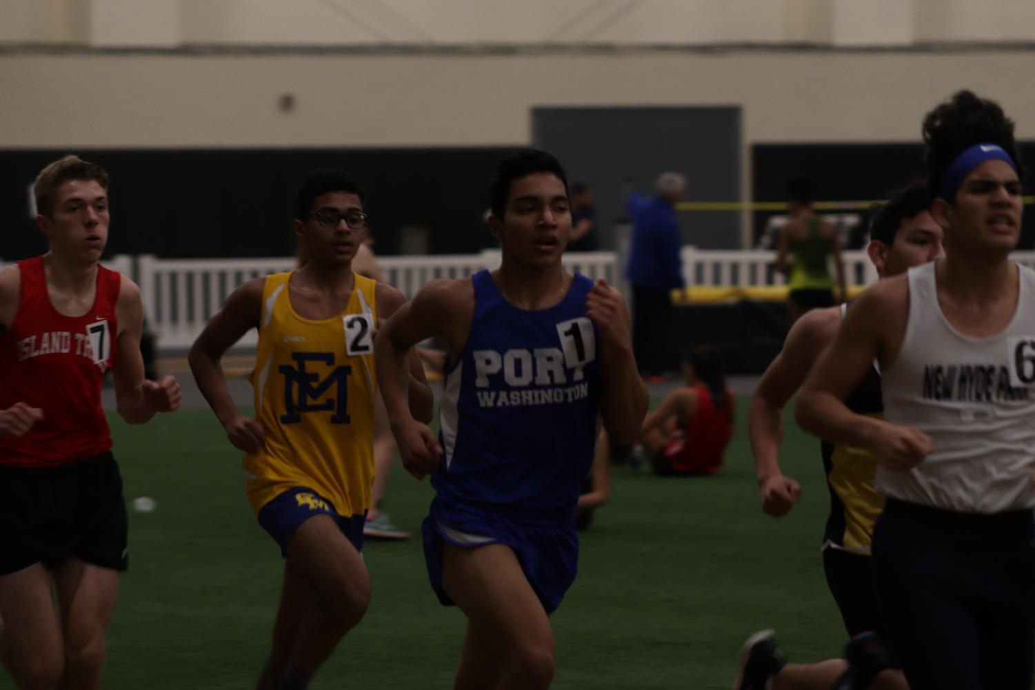 Olivar Melaria Perez competes in the 3200m race at St. Anthony's on Jan. 10.