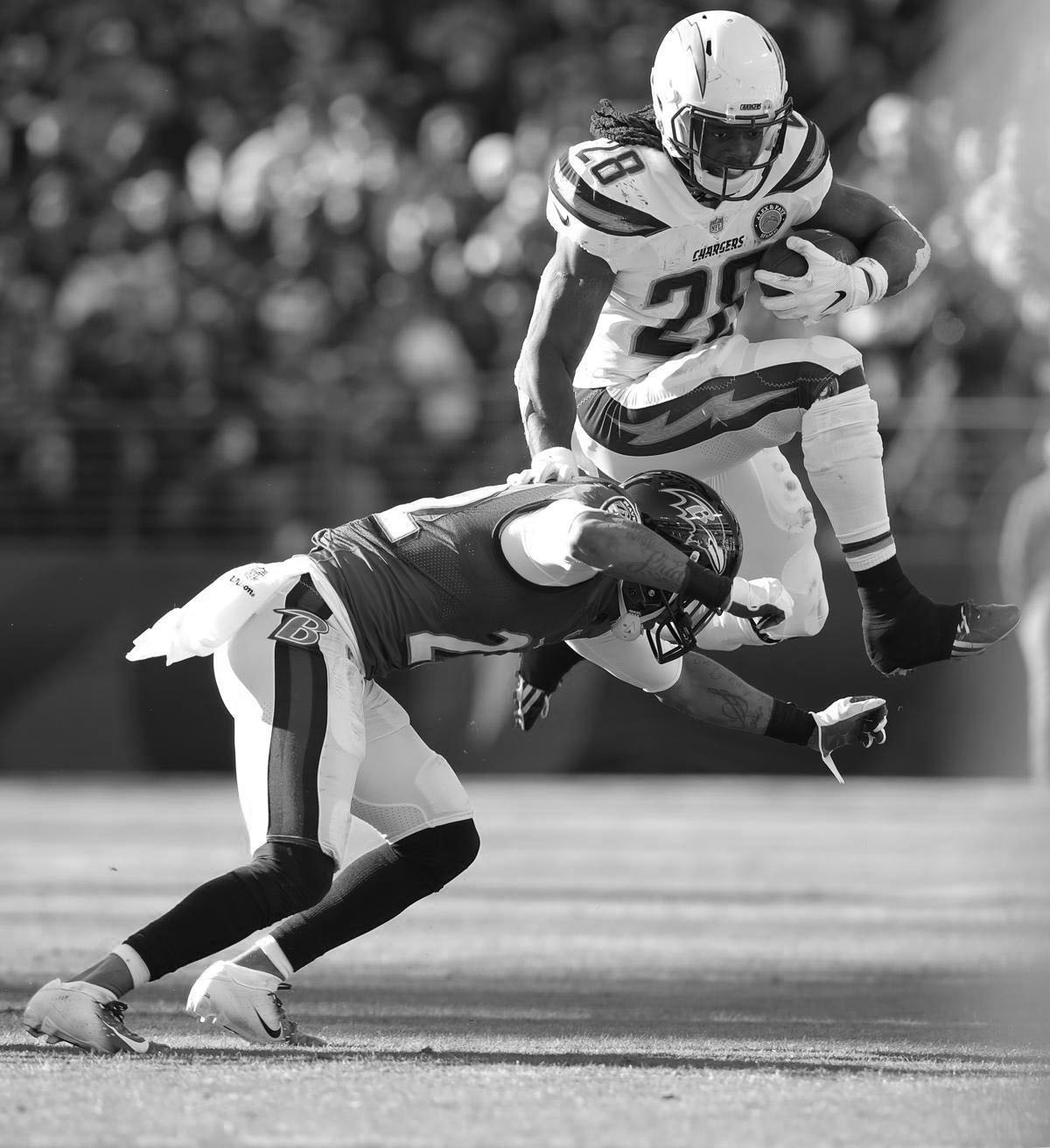 Los Angeles Chargers running back, Melvin Gordan, attempts to hurdle a defender in the NFC Divisional Round, on Jan. 6, 2019, which the Chargers won 23-17.