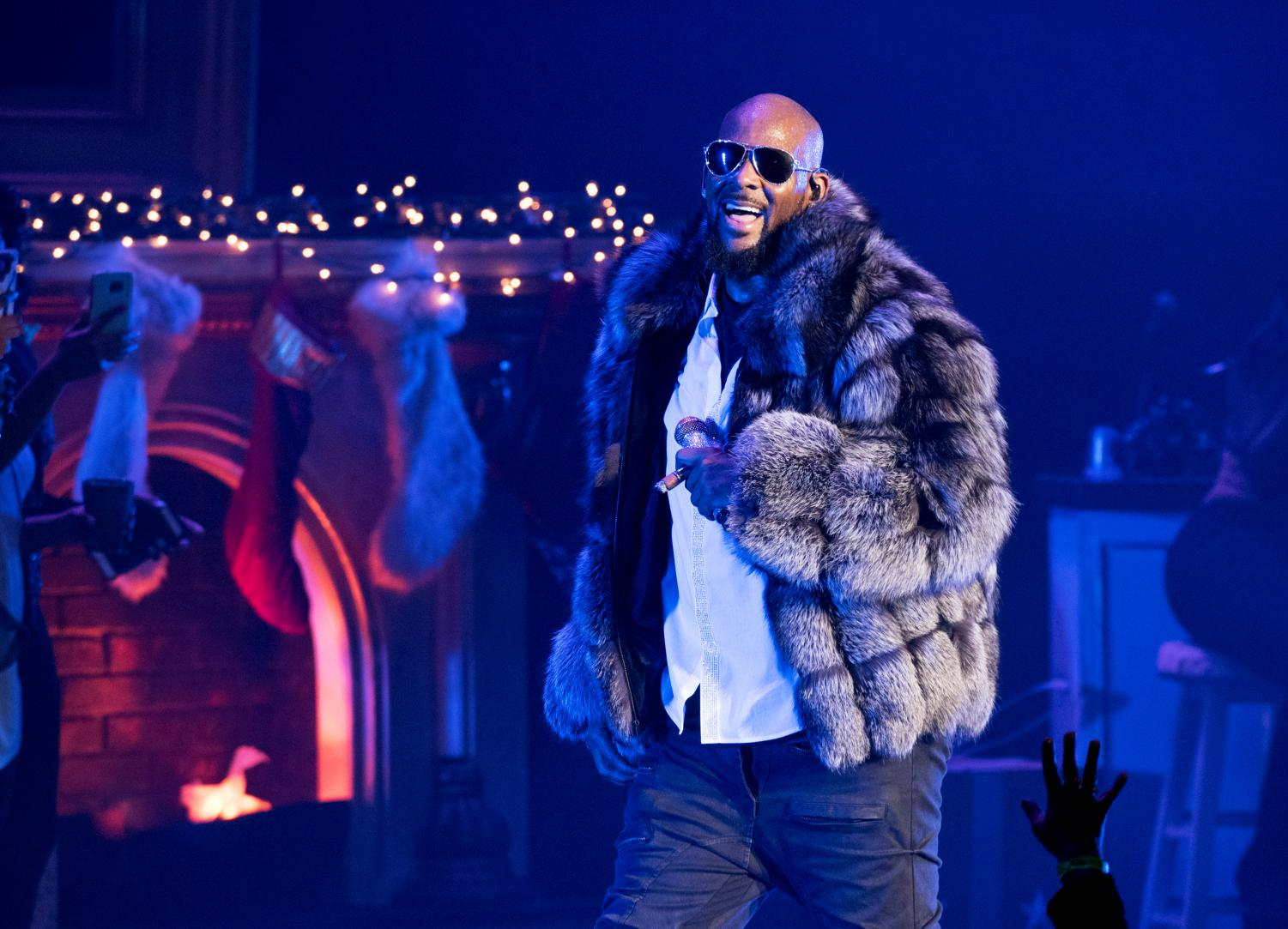 Singer and Rapper R. Kelly performs onstage back in 2013 amidst multiple accusations of sexual assault, which would prompt a controversial protest among women years later.