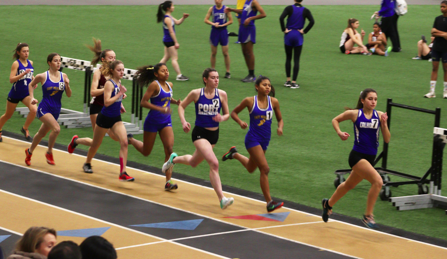 Junior Caroling Pangbourne and junior Sam Krayeski run the 1500m race during the Conference Championship at St. Anthony's High School on Jan. 31.